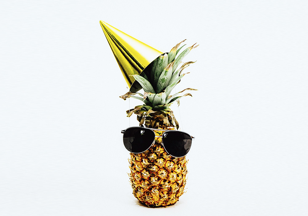 Pineapple with party hat sunglasses