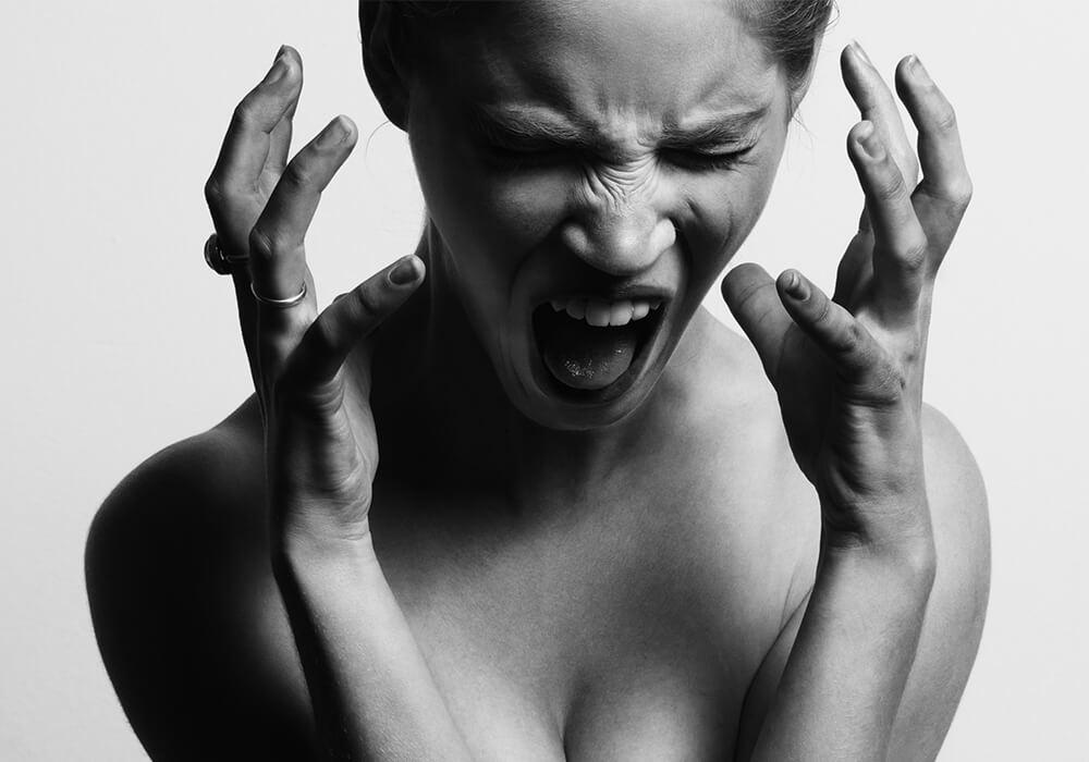 Kvinna i smärta